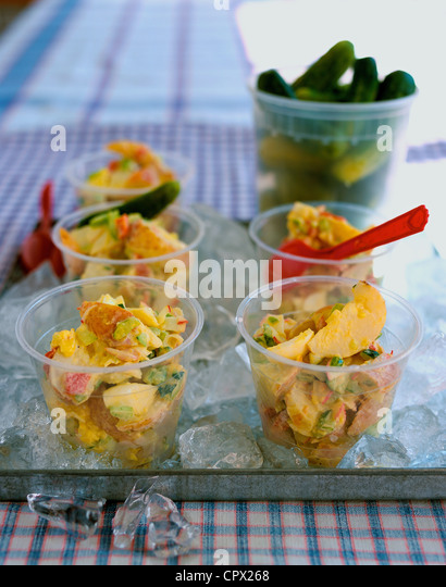 Potato salad in bowls on tray of ice - Stock Image