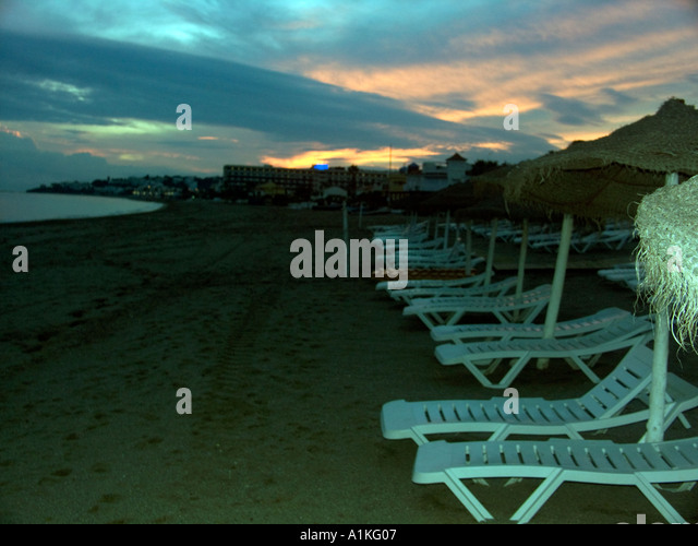 Sunbeds at Sunset La Cala beach Spain Spanish La Cala de Mijas Europe European Spanish beaches sunbed sun lounger - Stock Image