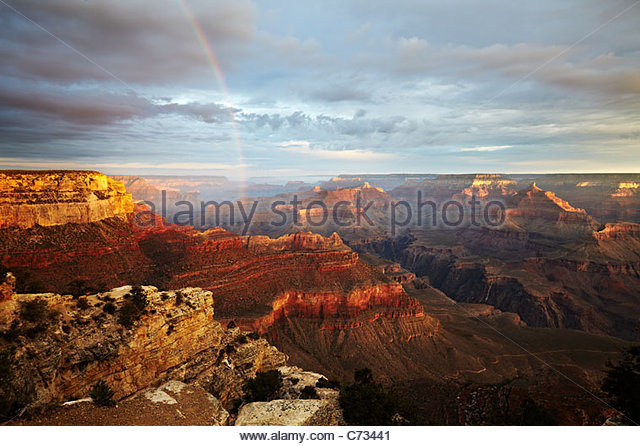 The sunrise, morning light and rainbow across the Grand Canyon, Arizona, USA - Stock Image