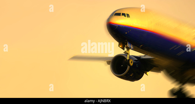 Close up of commercial airplane with blur and copy space - Stock Image