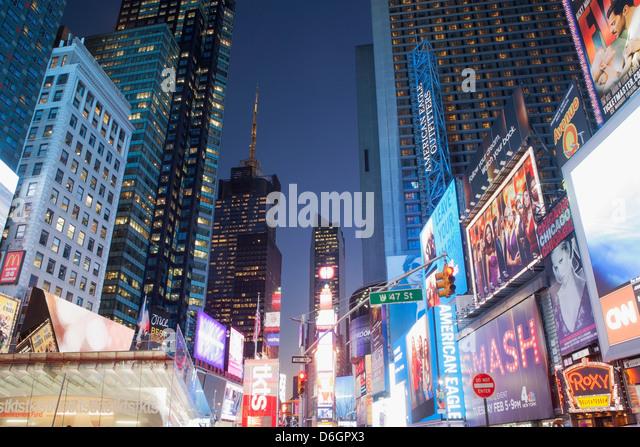 Illuminated billboards in Times Square - Stock Image