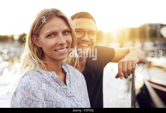 Couple Sitting on their Boat, Smiling at Camera - Stock Image