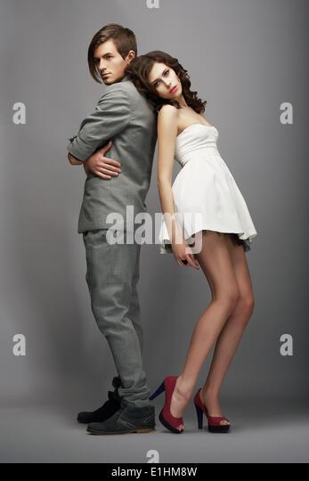 Sensuality. Romance. Newlyweds Couple Back to Back - Stock Image