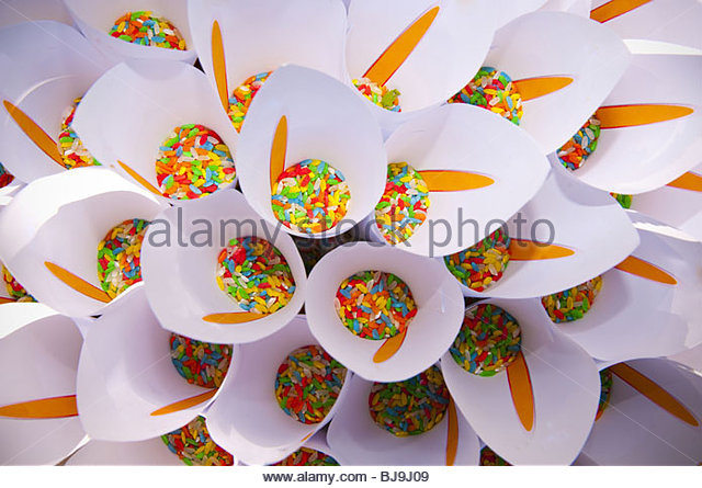 Multi colored wedding rice in pouches - Stock Image