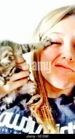 Girl with Kitten - Stock Image
