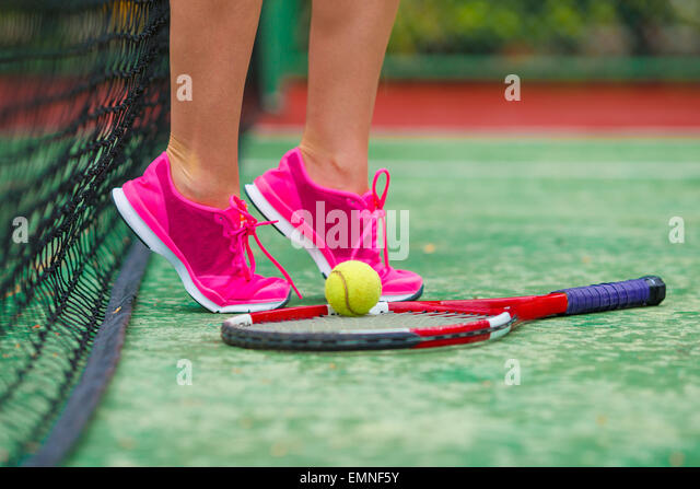 Close up of sneakers near the tennis racquet and ball - Stock-Bilder