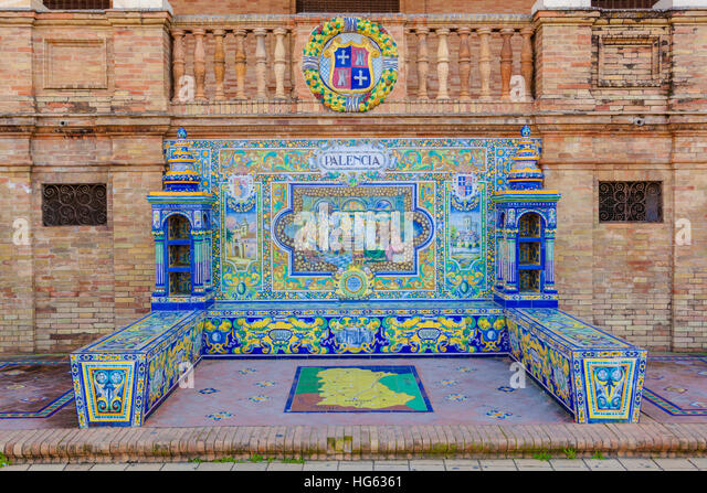 Glazed tiles bench of spanish province of Palencia at Plaza de Espana, Seville, Spain - Stock Image