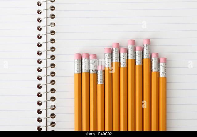 School education still life pencils on notebook - Stock Image