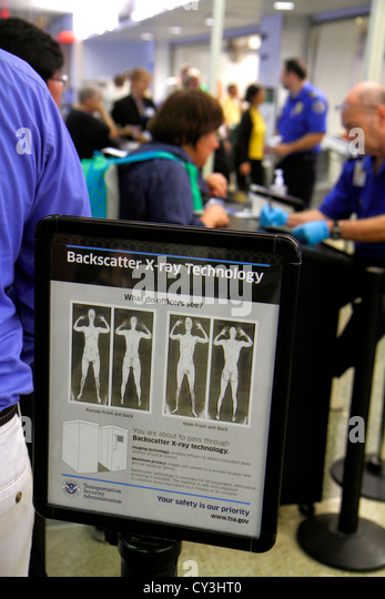 Massachusetts Boston Logan International Airport BOS concourse terminal security check checkpoint body scanner TSA - Stock Image