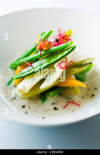 Steam-cooked vegetables with truffle emulsion - Stock Image