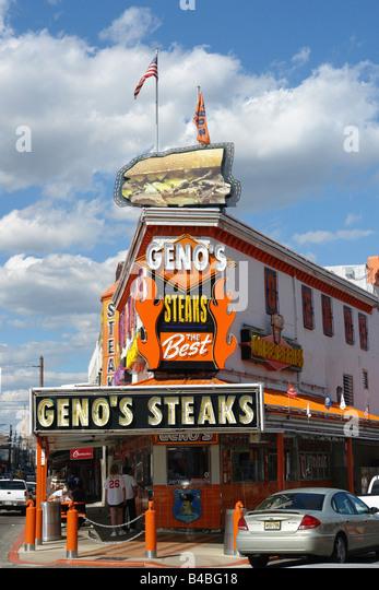 Urban Scene of Landmark Philadelphia Cheesesteak Vendor Geno's - Stock Image