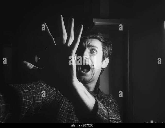Halloween scream, man scared from something - Stock Image