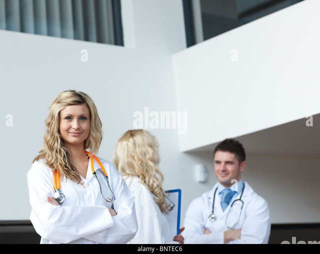 Three doctors in a hospital - Stock Image