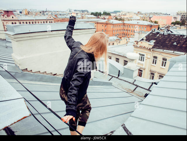 two cool blond real girls friends making selfie on roof top, lifestyle people concept, modern teens close up - Stock Image