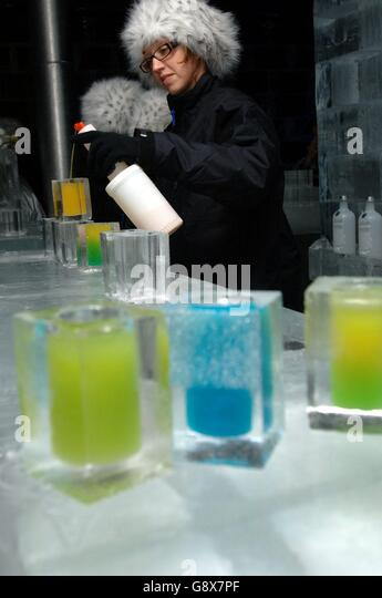 Drinks are served at a photocall celebrating the launch on October 1st of The Absolut Ice Bar, the UK's first - Stock Image