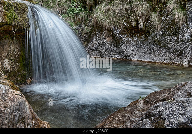 long time exposure on the river in Val Vertova, spring season near city of Bergamo - Lombardy, Italy - Stock Image