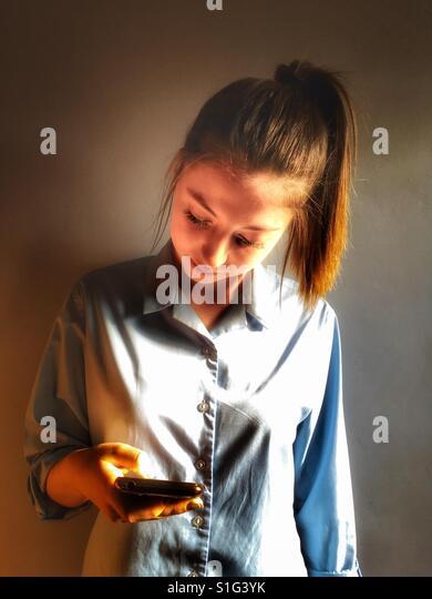 Schoolgirl reading text - Stock-Bilder