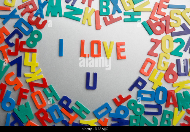 'I Love U' - Refrigerator magnets spell messages out of a jumble of letters - Stock-Bilder