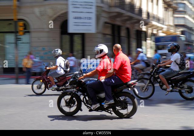 Argentina Buenos Aires Avenida de Mayo street scene intersection motorcycle bike transportation motion moving traffic - Stock Image