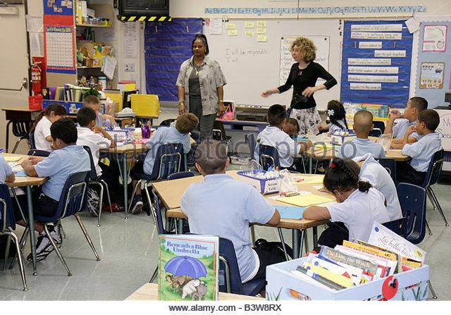 Miami Florida Comstock Elementary School Black woman women teacher students student boy boys girl girls school class - Stock Image