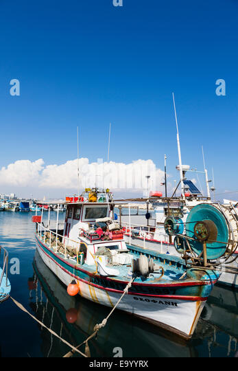 Traditional Cypriot fishing boat in Larnaca fishing harbour. - Stock Image