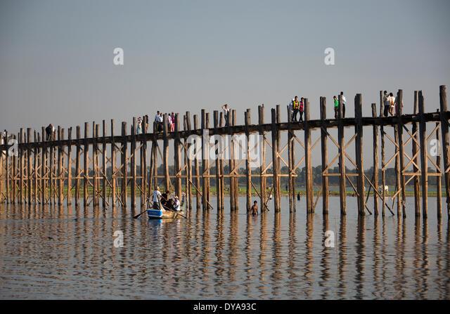 Amarapura Mandalay Myanmar Burma Asia Thaungthaman boat bridge famous lake long popular reflection teka sunset touristic - Stock-Bilder