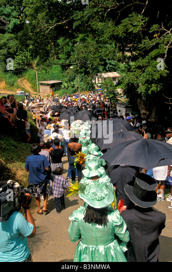 Tobago Heritage Festival Moriah village Old Time Wedding procession marches through the streets women in bright - Stock Image