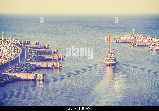 Retro vintage filtered picture of an old sailing ship leaving port in Kolobrzeg, Poland. - Stock-Bilder
