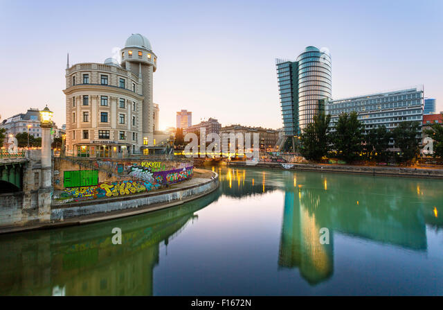 Austria, Province Vienna, Vienna, Urania, Uniqa Tower and danube channel in the evening - Stock Image