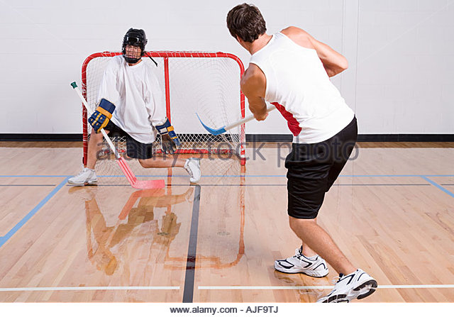 Hockey goalkeeper making a save - Stock Image