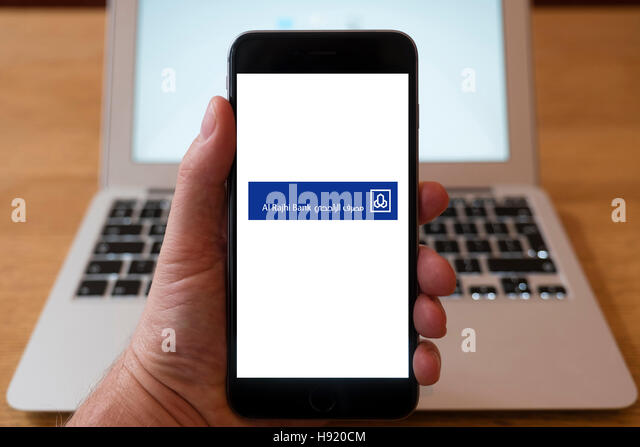 Using iPhone smart phone to display website logo of Al Rajhi, Islamic bank n Saudi Arabia - Stock Image