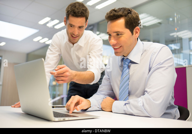 Males computer pc desk planning work tie - Stock Image