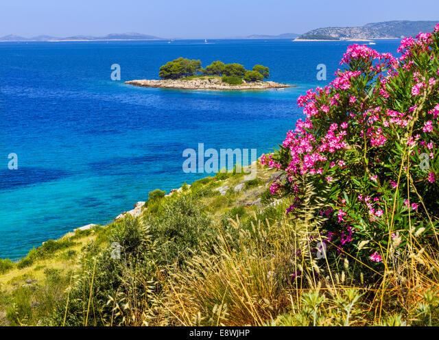 Croatia coast, beach, blue sea holiday happy sun summer holiday feeling mood Happiness Boat dive coastal rocky stones - Stock Image