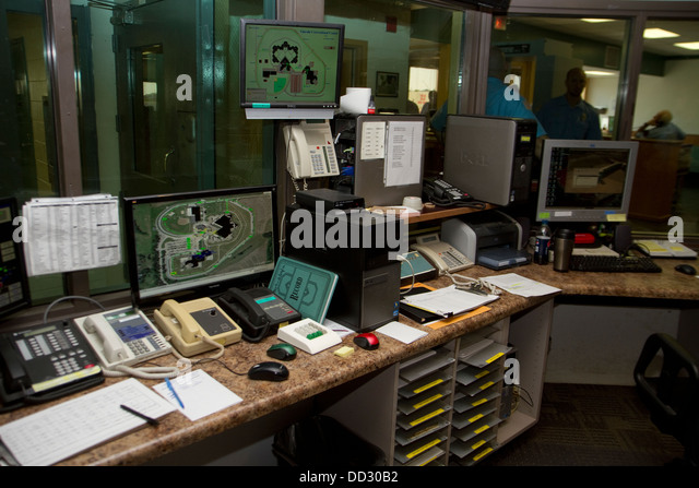 Master Control is the technological hub of prison where doors can be locked and opened remotely, alarm systems monitored - Stock Image