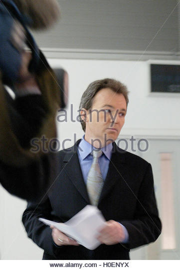 Peter Foster gives a live, televised statement in London, December 16,  2002. Convicted fraudster Foster, whose - Stock Image