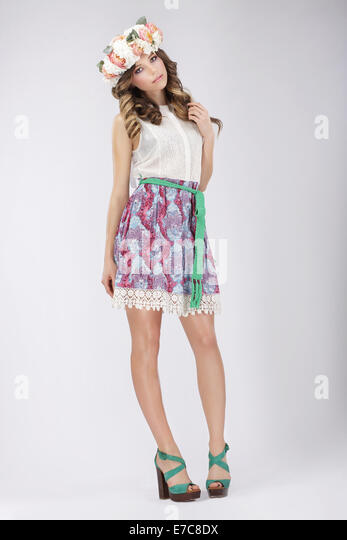 Young Woman in Lacy Skirt and Blouse with Flowers - Stock Image