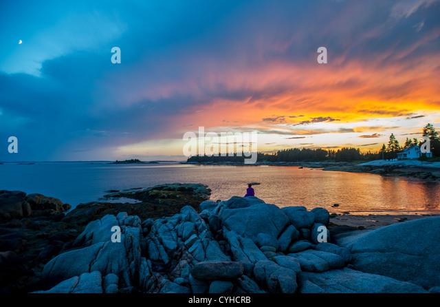 Sunset on the rocky terrain of Deer Isle, Maine - Stock Image