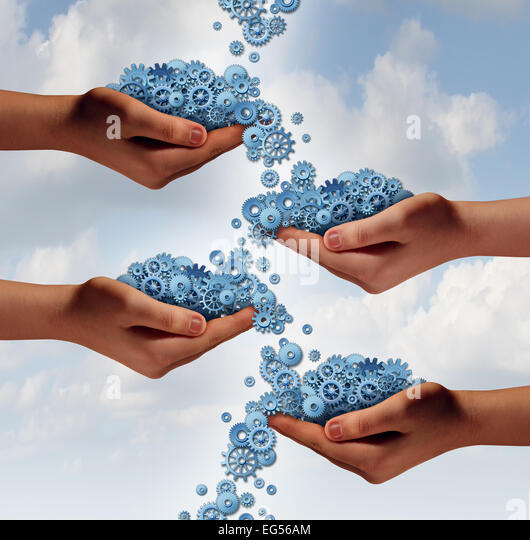 Social networking concept and organization symbol as a group of diverse hands exchanging cogwheels and gears in - Stock Image