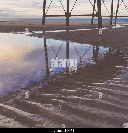 Sea puddle on sand - Stock-Bilder