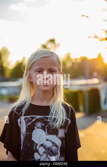Sweden, Smaland, Anderstorp, Portrait of blond girl (10-11) - Stock Image