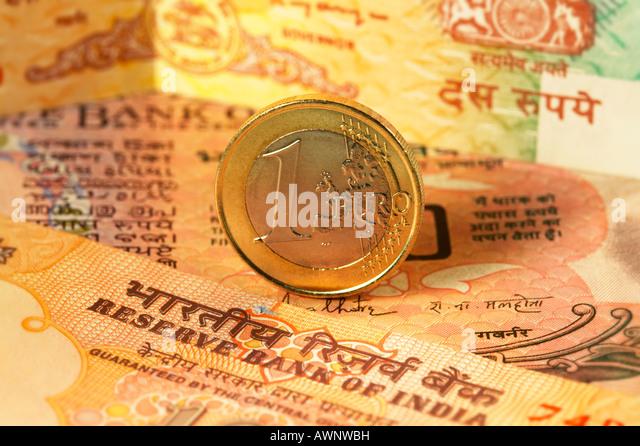 Euro Coin Indian Rupee Bank notes close up - Stock Image