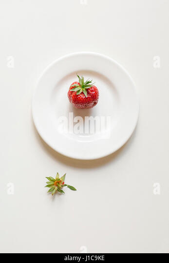 Strawberry on white plate - Stock Image