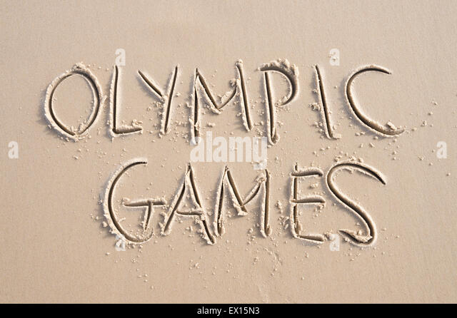 RIO DE JANEIRO, BRAZIL - MARCH 20, 2015: Olympic Games message written in the sand in anticipation of the city hosting - Stock Image
