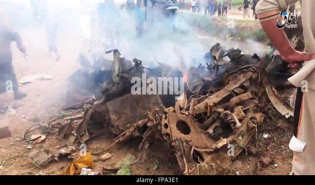 An ISIS propaganda video showing Islamic State militants around the wreckage of an Iraqi Air Force AC-208B Combat - Stock Image