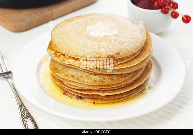 Pile of delicious handmade pancakes on table - Stock Image