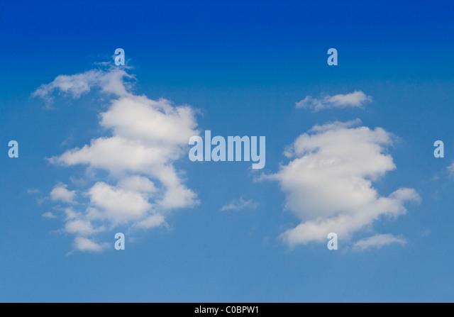 Fluffy cumulus clouds and a blue sky - Stock-Bilder