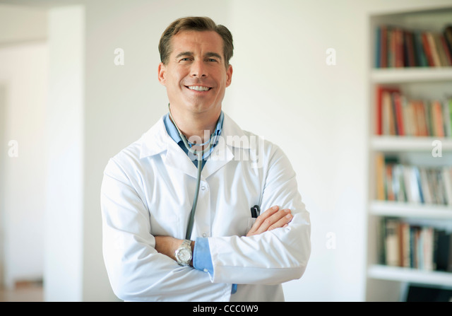 Doctor with arms folded, portrait - Stock Image