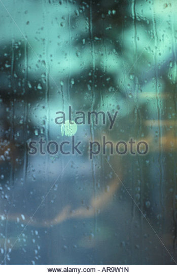 Rain on window Flowing water pattern concept - Stock Image