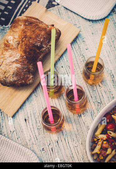 High angle view of bread loaf and elderflower drinks - Stock Image