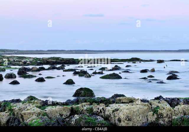 View of Largo Bay taken at dusk from the beach at Lower Largo in the East Neuk of Fife, Scotland. - Stock Image